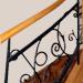 Schody drewniane z wypełnieniem balustrady typu metaloplastyka, kute